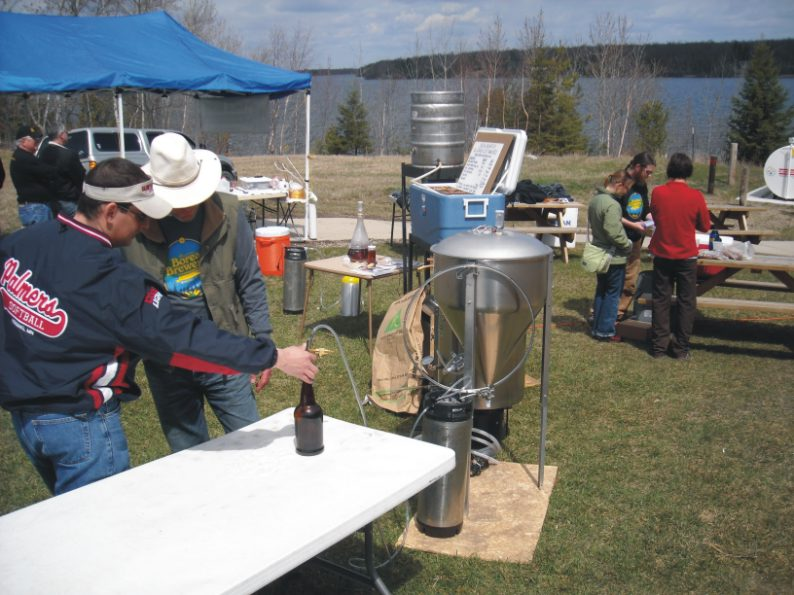 Larry showing how to bottle from a keg